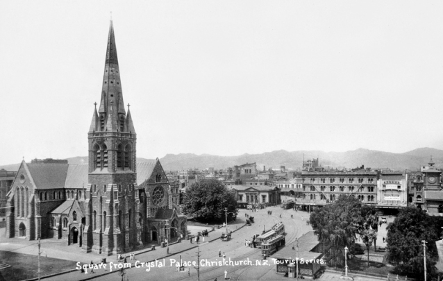 Cathedral Square including Christchurch Cathedral circa 1918. Photo taken from The Crystal Palace. The Crystal Palace was a Picture Theatre built in 1918. Wonderful view of the Square with 4 trams, several horse drawn vehicles, the old Bank of New Zealand, and the United Services Hotel in the background and the Strand Picture Theatre at right.