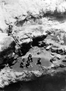 Maori children bathing in termal pool