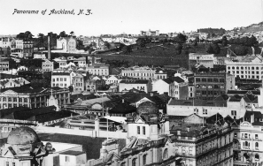 Looking south from Ferry Building over city showing part of Post Office (foreground) and the Waverley Hotel in Queen Street, Tyrone Buidings, John Burns, and L D Nathans tea factory (right to left), in Customs Street East, R Peace and Son, plumbers, Bycrofts Limited, Waikato House and Winks and Hall in Shortland Street (left to right middle distance), New Zealand Express Company, central sample rooms, and Auckland Safe Deposit Buildings in High Street (right, middle distance), with the Synagogue, Auckland Hospital and Albert Park (left to right, distance)