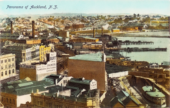 Looking west from the Ferry Buildings towards Freemans Bay, showing the Auckland Sailors Home, Seaman's Mission Hall, Union Oil Soap and Candle Company, S Winterbourne and Company and Wingate and Company on Albert Street (foreground, centre to left), the Graving Dock (right foreground), A and T Burt Limited on Customs Street West (left middle distance), New Zealand Loan and Mercantile Agency on corner of Federal Street and Fanshawe Street (previously Customs Street West), also showing other premises on Fanshawe Street including Grove and Sons and Gleesons Hotel on the corner of Hobson Street, Hobson Street crosses Fanshawe and Customs Street West and runs down to the morgue and premises of Carder Brothers and Company (extreme right, middle distance), Sam White and Sons is seen (centre distance) with the timber mills behind. The ferry in the dock is the Peregrine.